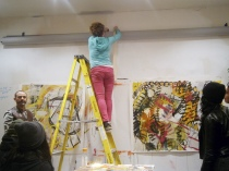 Rosemary taking down her biggest piece to show the Art Ready students. To keep the piece secured she has it taped to the wall and when she wants to show people she gets a ladder and takes off the tape and it falls down.