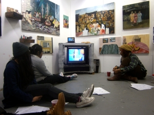 Students watch one of Maia's stop-motion animation videos