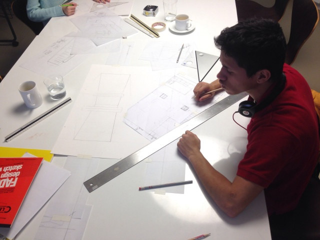 Fabio drawing a perspective of his dream apartment.
